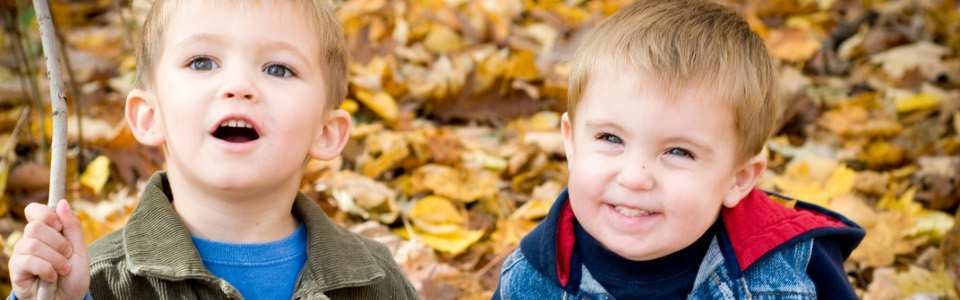 Two boys on a backdrop of leaves